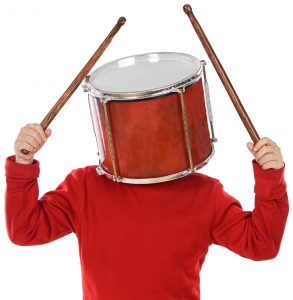A man with his head stuck in a drum, about to start playing, demonstrating how Energizer Bunny syndrome feels