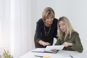 An executive reviewing results with a young businesswoman