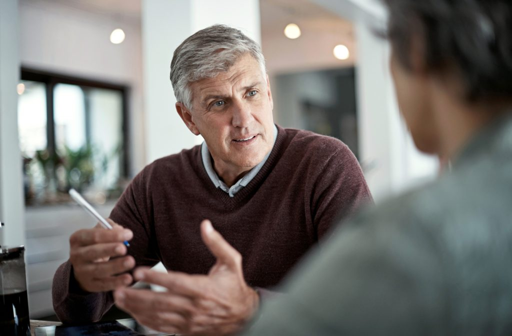 Businessman driving results through an intense discussion with a coworker