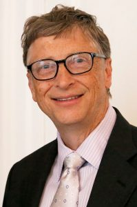 Bill Gates in 2014, wearing a black suit and silver tie